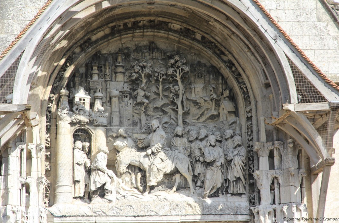 The tympanum of the church Notre-Dame of La Neuville